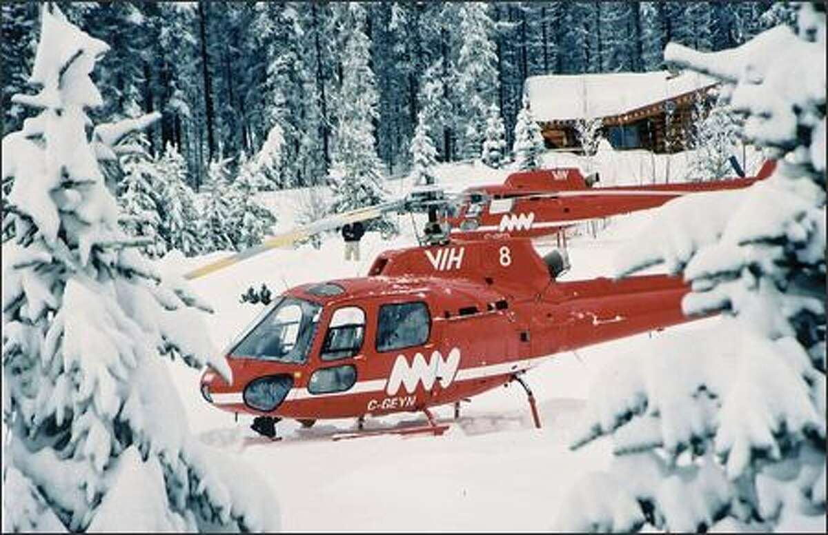 Two choppers pick up skiers and boarders at the Free Fall Chalet at Mike Wiegele's Blue River Resort, nestled between the Monashee and Cariboo ranges.