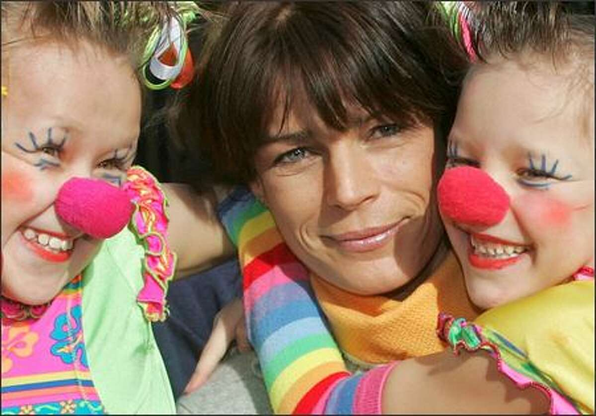 A cute princess and two cute kid clowns -- what's not to fall in love with in this portrait from the tony environs of Monte Carlo? Princess Stephanie, 39, the wild child of the late Grace Kelly and Prince Rainier of Monaco, poses with excited clownettes on the eve of the 30th annual Monte Carlo International Circus Festival.