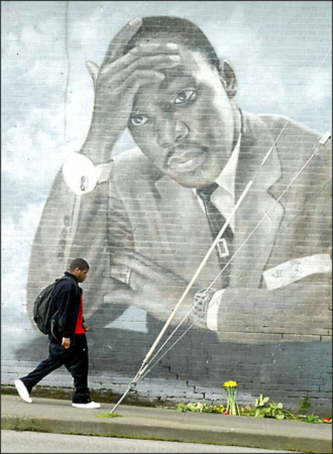 In commemoration of King's birthday, schoolchildren brought flowers and notes addressed to the slain peace activist and placed them below the mural at the intersection of MLK Way East and East Cherry Street. Photo: Paul Joseph Brown, Seattle Post-Intelligencer / Seattle Post-Intelligencer