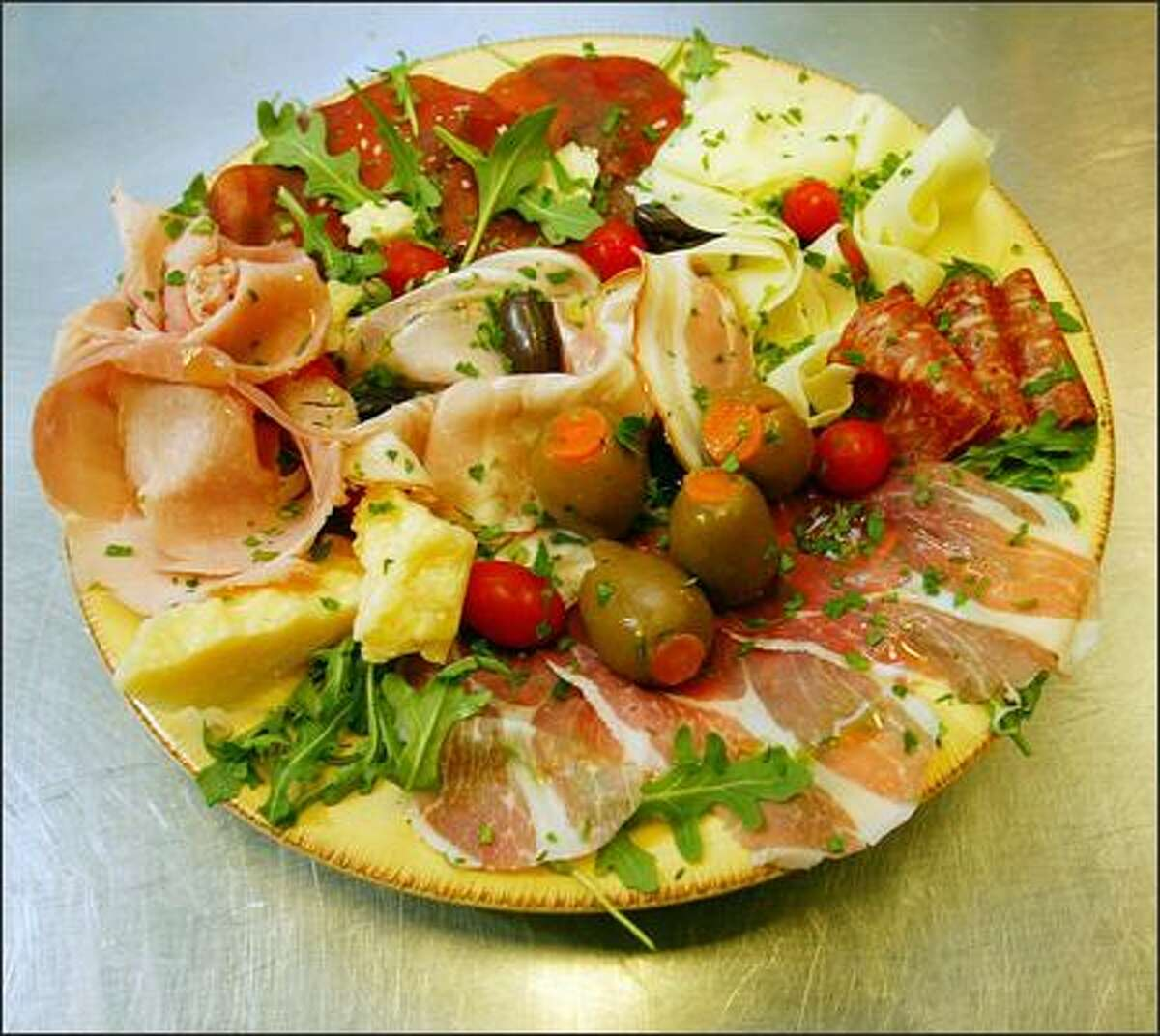 One of the best bets at Mondello is the antipasto misto, a nice, shareable plate of salami, porchetta, artichoke hearts, fresh mozzarella, roma tomatoes and roasted red peppers.