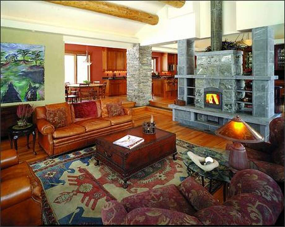 This large masonry fireplace doubles as a room divider and radiates heat to a very large area. (RON PIHL)