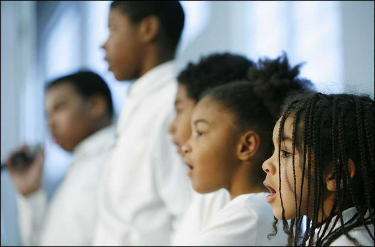 The Ebenezer Youth Choir sings Monday at the 27th annual Martin Luther King Jr. celebration rally at Garfield High School.
