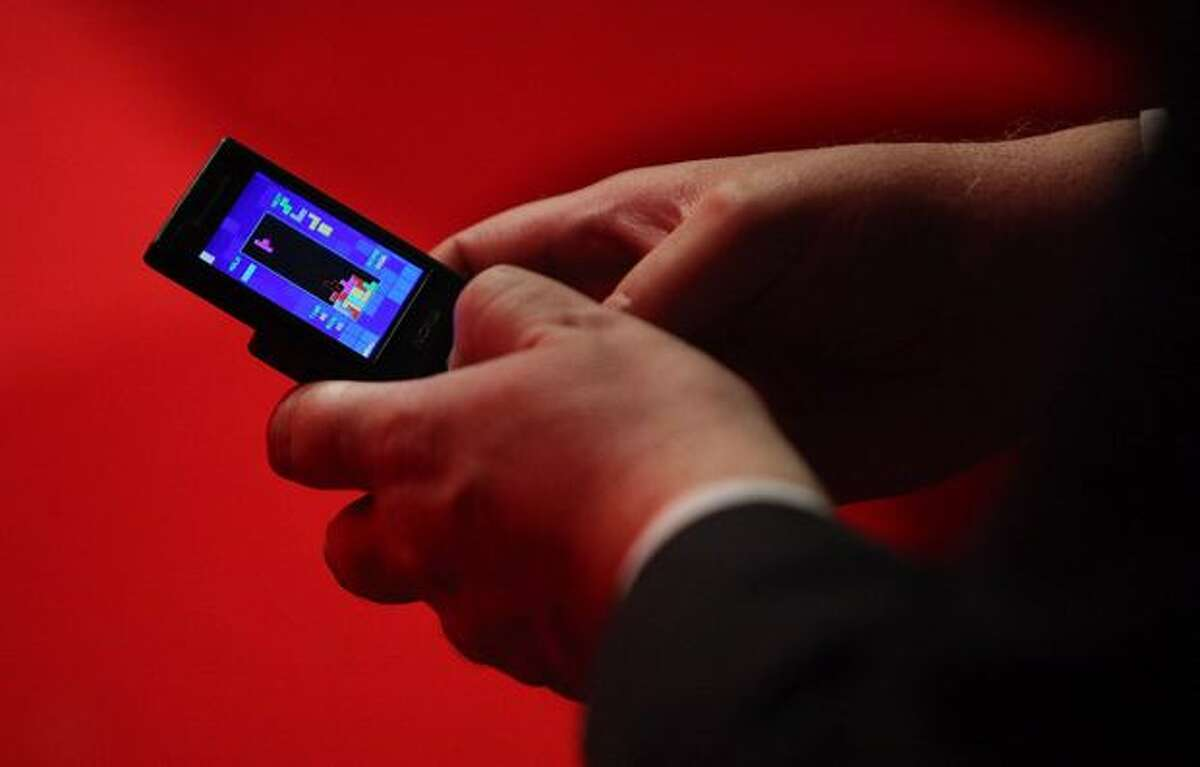 A delegate plays a game of Tetris on his mobile phone during the speeches on the fourth day of the Labour Party Conference on Sept. 30, 2009 in Brighton, England.