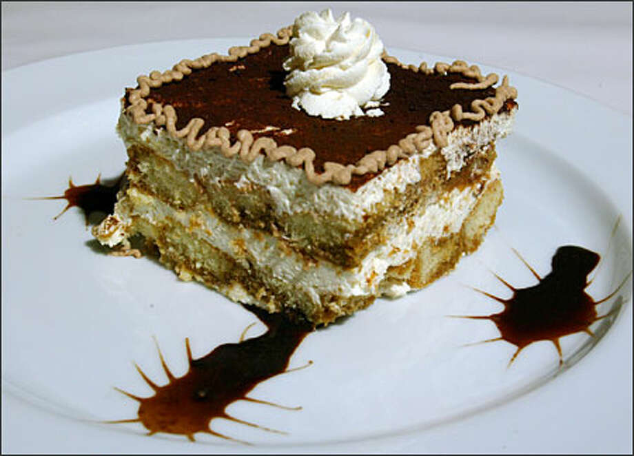 Villa Cosenza's tiramisu is the only house-made dessert and has a heavier, creamier texture and a lighter flavor than usual. Photo: Grant M. Haller, Seattle Post-Intelligencer / Seattle Post-Intelligencer