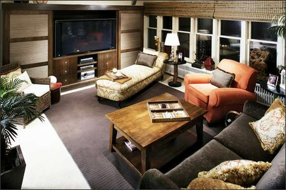 A flourish of feminine and a modest amount of masculine combine in a family room that works for both sexes.