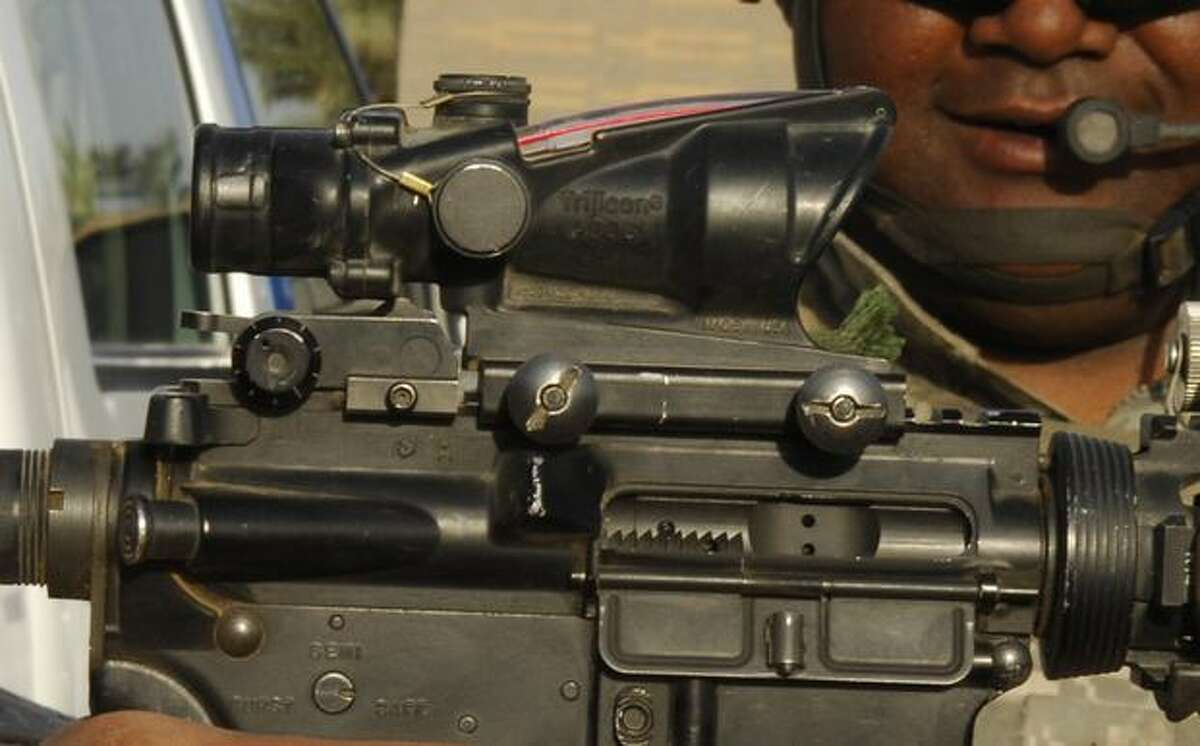 This handout photo provided by the Defense Department, taken March 25, 2009, shows an M-4 carbine assault rifle at a post in Hayy, Iraq. Combat rifle sights used by U.S. forces in Iraq and Afghanistan carry references to Bible verses, stoking concerns about whether the inscriptions break a government rule that bars proselytizing by American troops. (AP Photo/Staff Sgt. Rasheen A. Douglas, Defense Department)