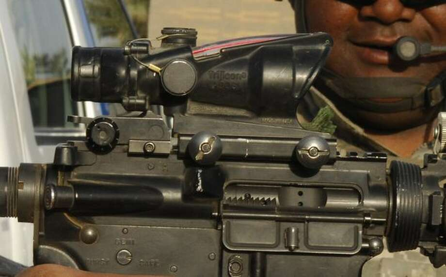 This handout photo provided by the Defense Department, taken March 25, 2009, shows an M-4 carbine assault rifle at a post in Hayy, Iraq. Combat rifle sights used by U.S. forces in Iraq and Afghanistan carry references to Bible verses, stoking concerns about whether the inscriptions break a government rule that bars proselytizing by American troops. (AP Photo/Staff Sgt. Rasheen A. Douglas, Defense Department) Photo: Associated Press / Associated Press