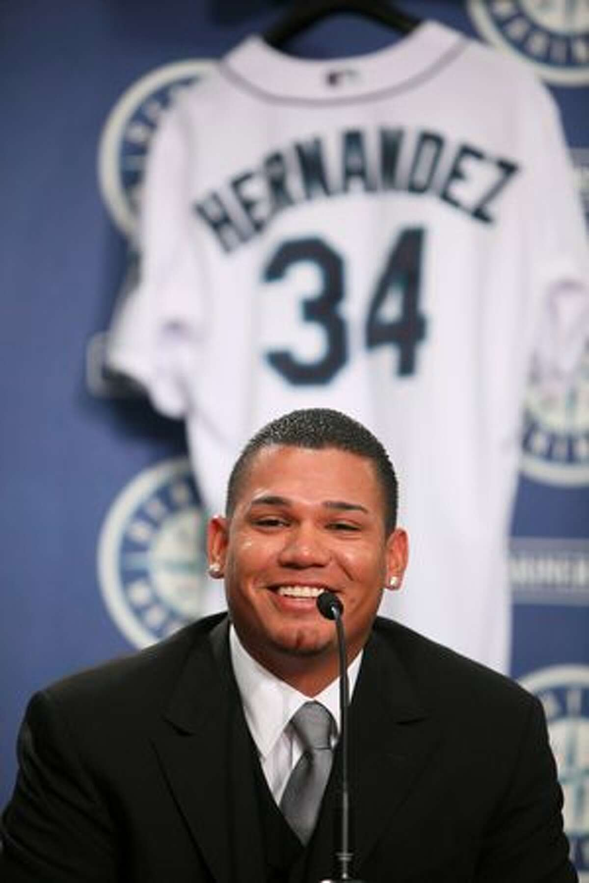 Pitcher Felix Hernandez announces during a press conference Thursday at Safeco Field that he is staying with the Mariners for five more years.
