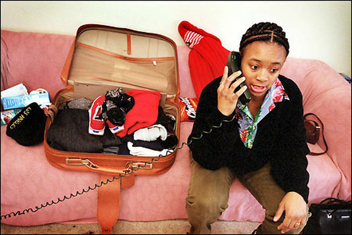 Denise McNary checks in with a friend before leaving for a church-organized retreat over the weekend. She was laid off by The Boeing Co. in December.