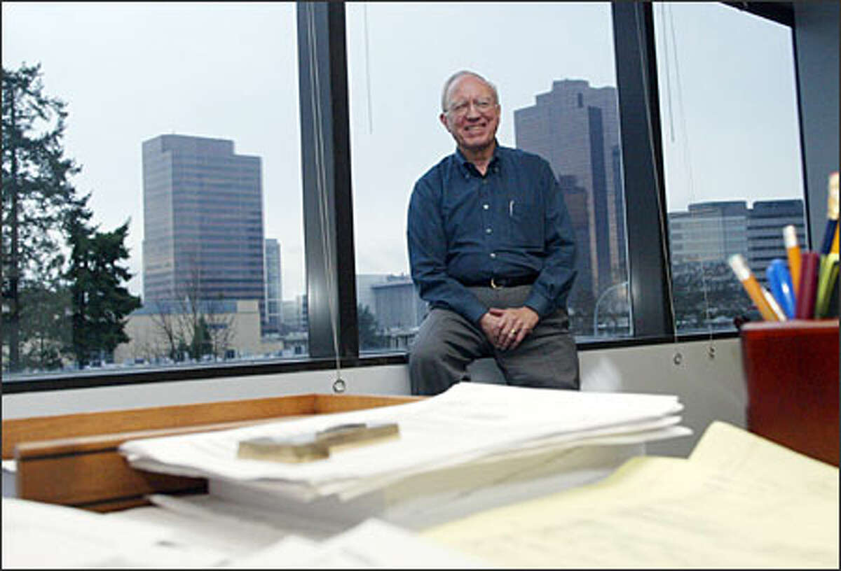 Harold Anderson, president of insurance company Kenneth I. Tobey Inc., is all smiles in his new office space in the Plaza East building in Bellevue.