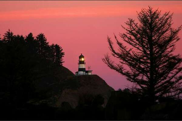 A sailor's delight: A January evening sky glows red behind the Cape Disappointment Lighthouse.