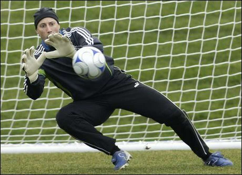 Sounders FC goalkeeper Kasey Keller makes a stop as he takes part in the first day of training camp at Seahawks headquarters. Photo: Associated Press / Associated Press
