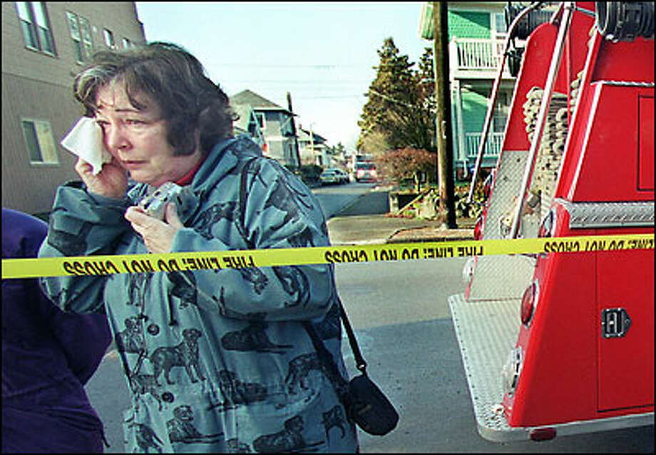 "Kay Morrison, whose children attended Coe Elementary School, wipes away tears yesterday after viewing the ruins of the venerable Queen Anne institution, destroyed by fire early Sunday. ""It was a content old place with memories you could feel when you sent inside,"" she said. Investigators were trying to pinpoint cause of the blaze. Photo: Renee C. Byer, Seattle Post-Intelligencer / Seattle Post-Intelligencer"