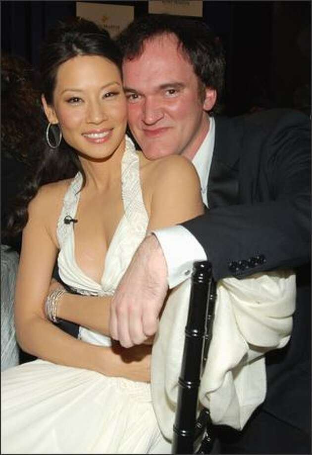 """This is not part of an audition for the latest version of """"Beauty and the Beast."""" Instead, actress babe Lucy Liu and chinmaster director Quentin Tarantino mug for the lens at the Asian Excellence Awards recently in L.A. where the two """"Kill Bill"""" vets each received an award. Photo: Associated Press / Associated Press"""