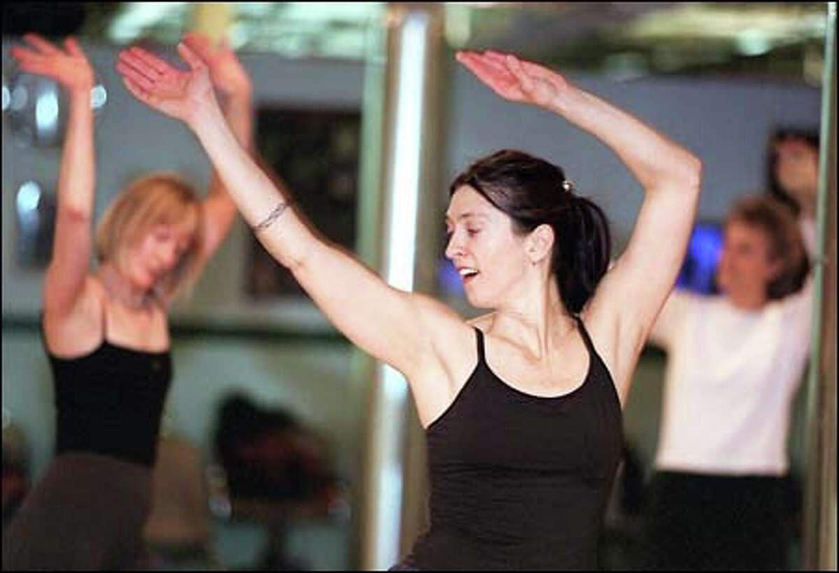 Christine Foro moves with the rhythm in a Nia workout at Paradise Dance Studio in Ballard. A form of no-impact aerobics, Nia is both structured and loose.
