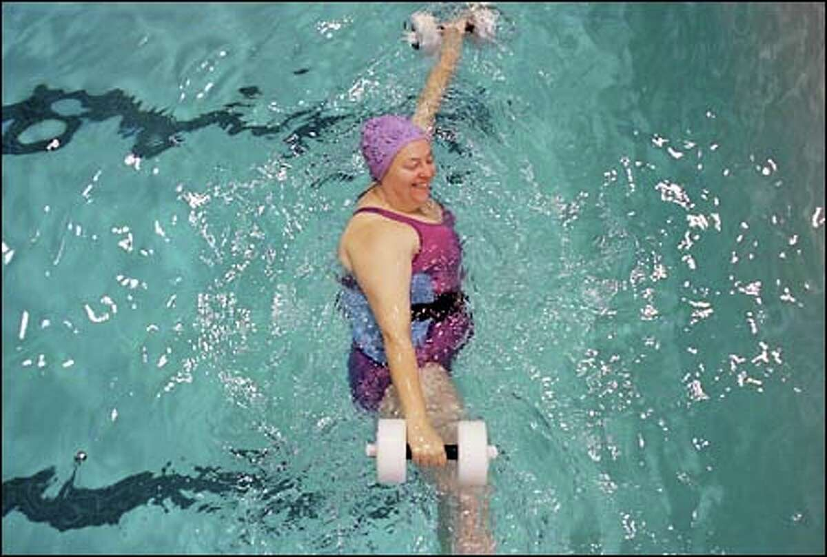 Sharon Nations uses flotation dumbbells in her hydrofit class at Evans Pool. Nations has been taking aquatic fitness classes since 1989.