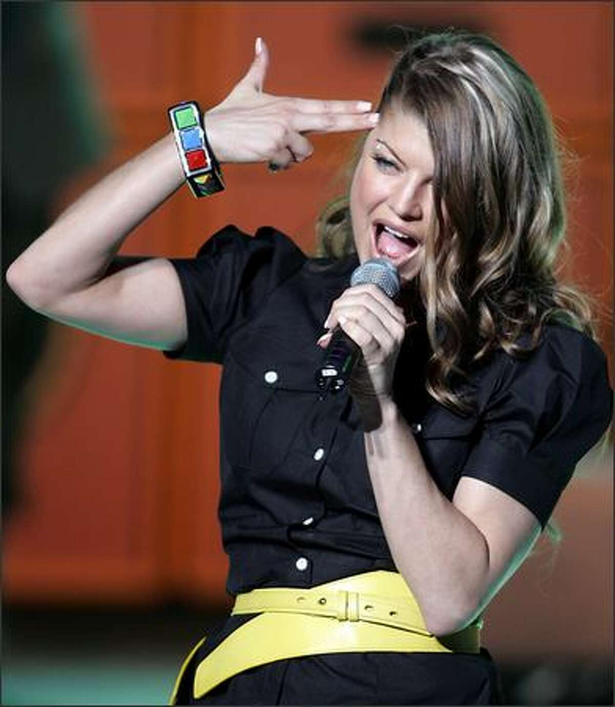 Rockers perform strange maneuvers on stage, but this pseudo-suicide pose by Fergie of the Black Eyed Peas sets a new standard for yuck. The singer did this number in France, after the Peas were named Best International Group at the NRJ Music Awards.