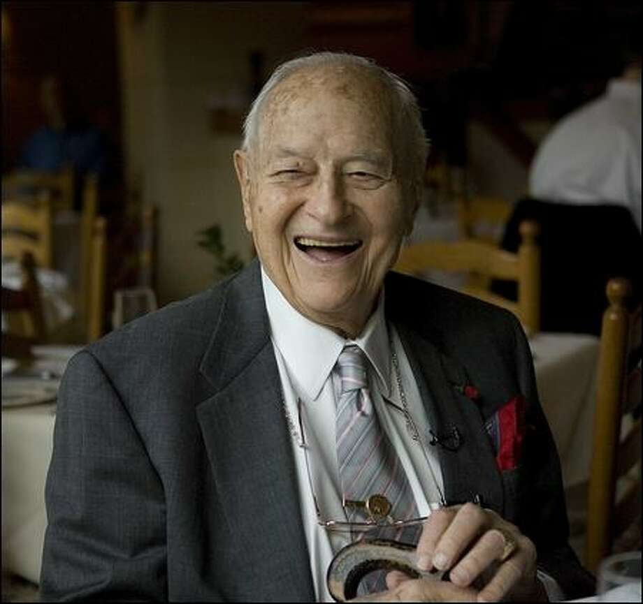 Albert Rosellini, after whom the state Route 520 Bridge is named, smiles at his 99th birthday party in 2009. He credited good food, good health, keeping busy and staying active for his longevity. (seattlepi.com archive photo). Photo: Grant M. Haller, Seattle Post-Intelligencer / Seattle Post-Intelligencer