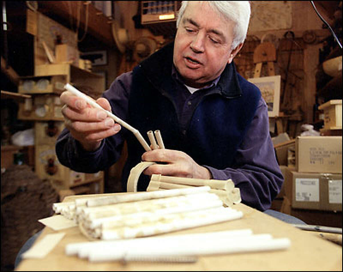 Brian Griffin loads bee-nesting tubes for shipment at his Bellingham workshop.