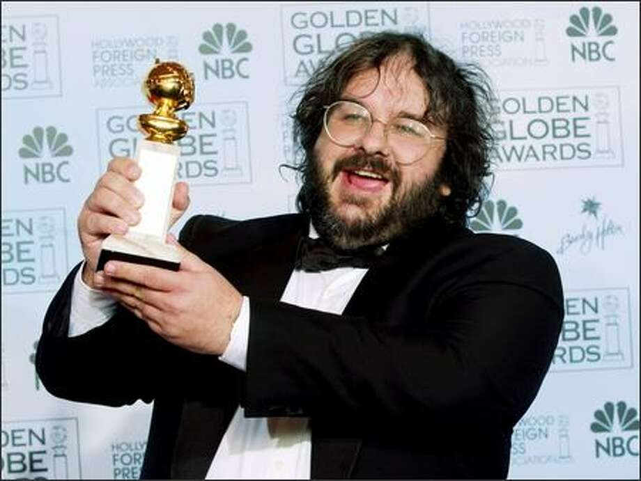 "New Zealand director Peter Jackson accepts the award for best director for his work on ""The Lord of the Rings: The Return of the King,"" at the 61st Annual Golden Globe Awards on Sunday in Beverly Hills, Calif. (AP Photo/Reed Saxon) Photo: Associated Press / Associated Press"