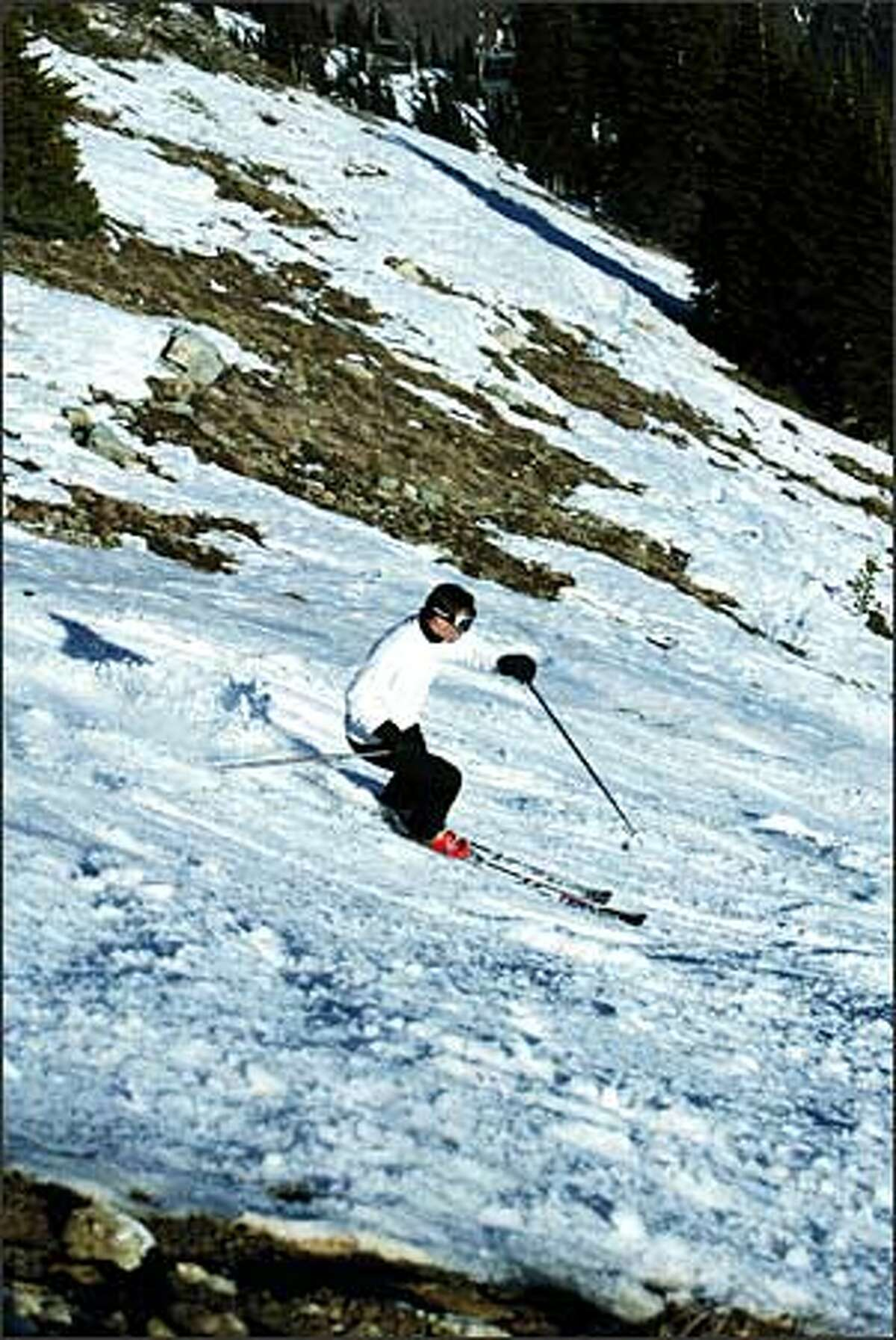 Karel Sir dodges rocks to take advantage of the only ski run in the region that's open daily: Crystal Mountain's Green Valley.