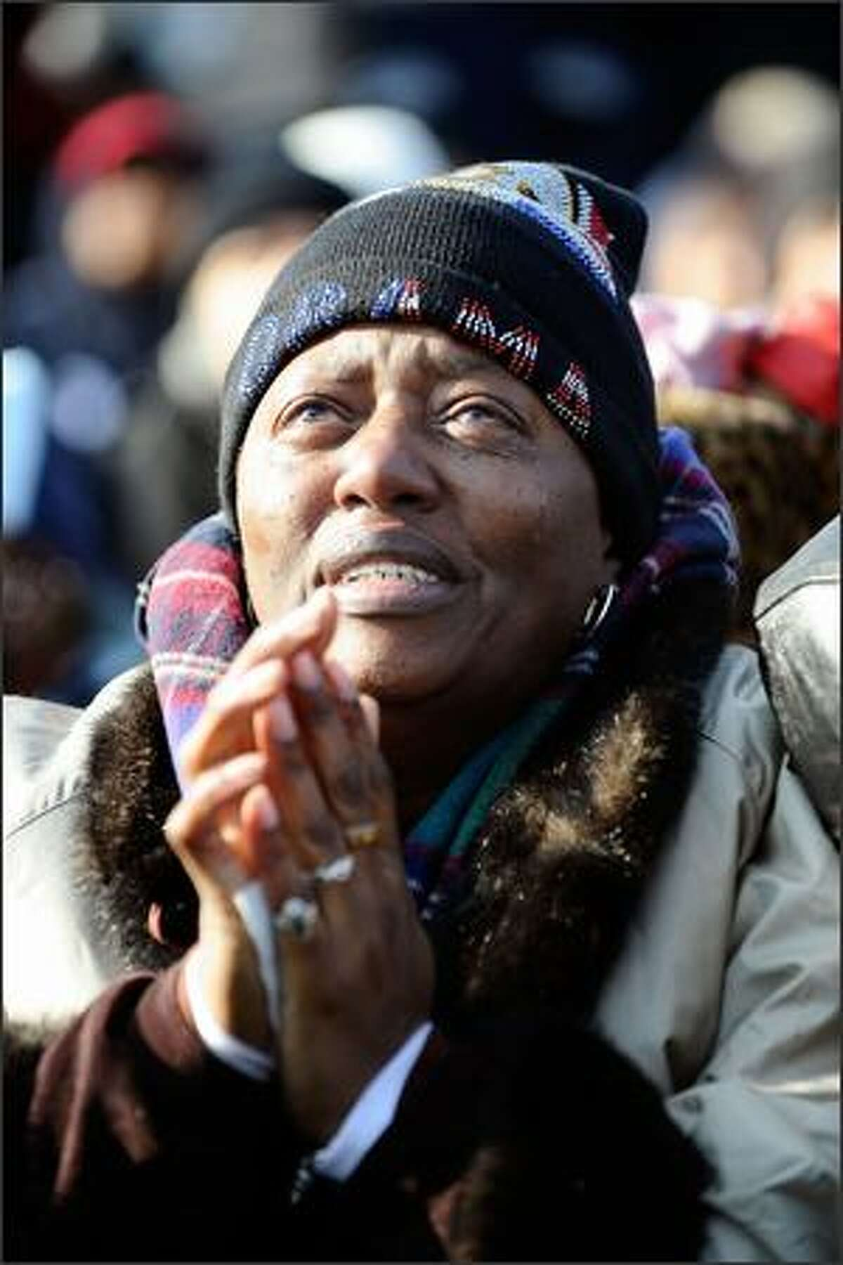 Patricia Brown of Atlanta, Georgia, reacts during the inauguration of Barack Obama as the 44th President of the United States on the National Mall, Jan. 20, 2009 in Washington, D.C.