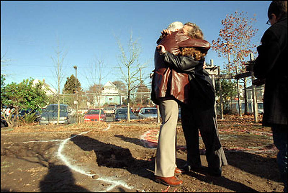 "Ralph Pearson hugs Claire Barnett after the groundbreaking for the ""Pathway Garden"" at John Hay Elementary School on Queen Anne. When Alaska Airlines Flight 261 plunged into the Pacific Ocean off the coast of Southern California last Jan. 31, it claimed the lives of several members in Pearson's and Barnett's families.  The garden is a memorial to four Hay students killed in the crash. Photo: Dan DeLong, Seattle Post-Intelligencer / Seattle Post-Intelligencer"
