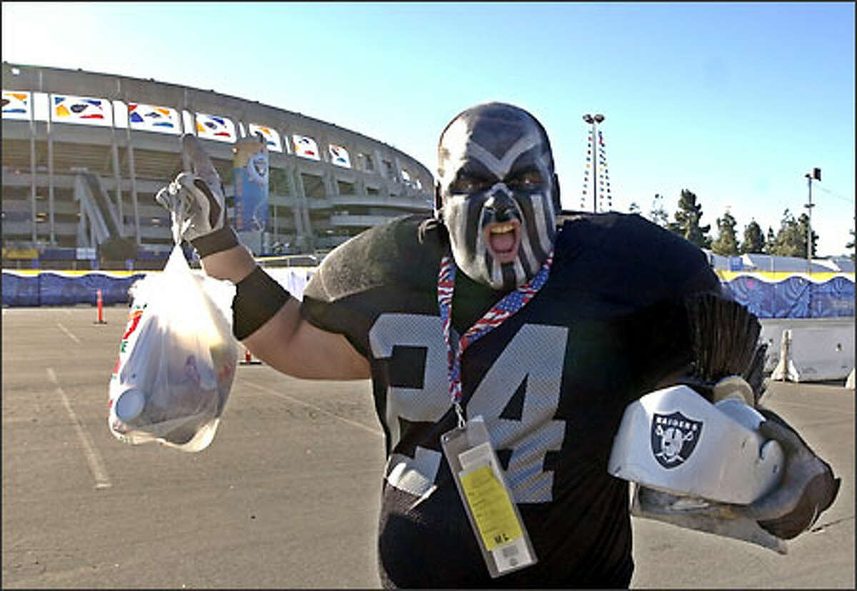 Joe Tuccinardi of Camino, Calif., wears his Glad-a-Raider costume as he arrives at Qualcomm Stadium for Super Bowl XXXVII in San Diego. The Oakland Raiders will play the Tampa Bay Buccaneers.