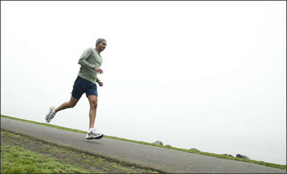 Asela Gunawardana of Seattle runs 30 miles a week. U.S. guidelines call for at least 30 minutes of exercise a day.