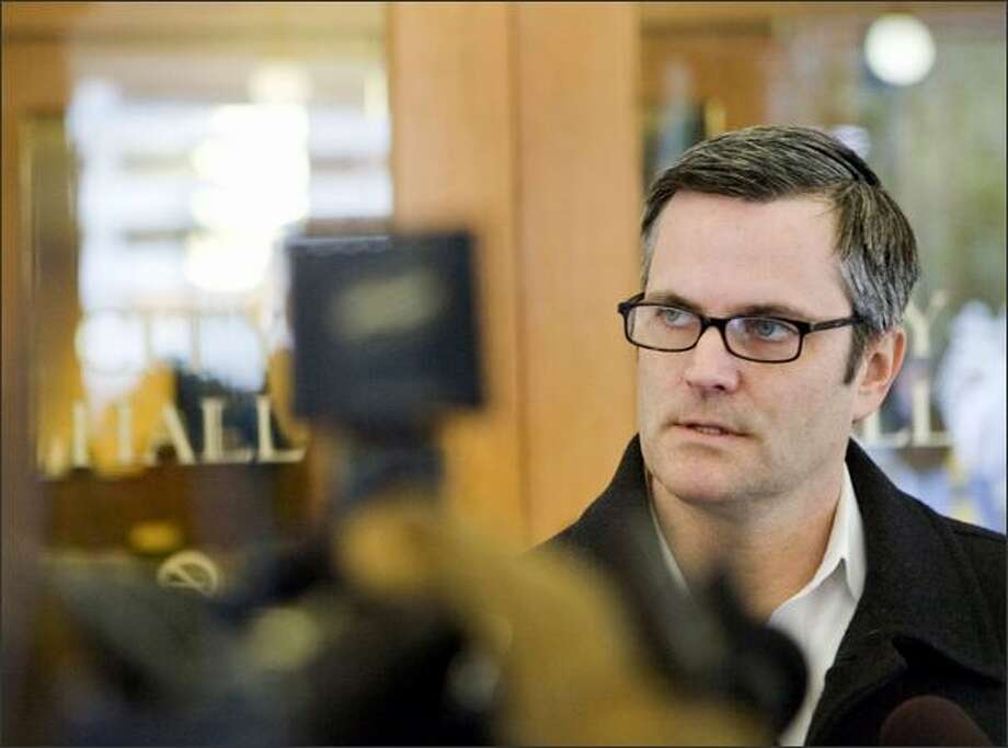 Mayor Sam Adams arrives at City Hall, Saturday morning Jan. 24, 2009, in Portland. Adams said Sunday he will not resign despite calls for him to step down after admitting he lied about a sexual relationship with a teenager. Adams is the first openly gay mayor of a major U.S. city. Photo: Associated Press / Associated Press
