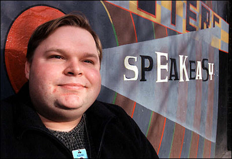 "With his non-disclosure agreement set to expire, Mike Daisey has turned his two years at Amazon.com into a one-man show, ""21 Dog Years: doing time@amazon.com."" Photo: Phil H. Webber, Seattle Post-Intelligencer / Seattle Post-Intelligencer"