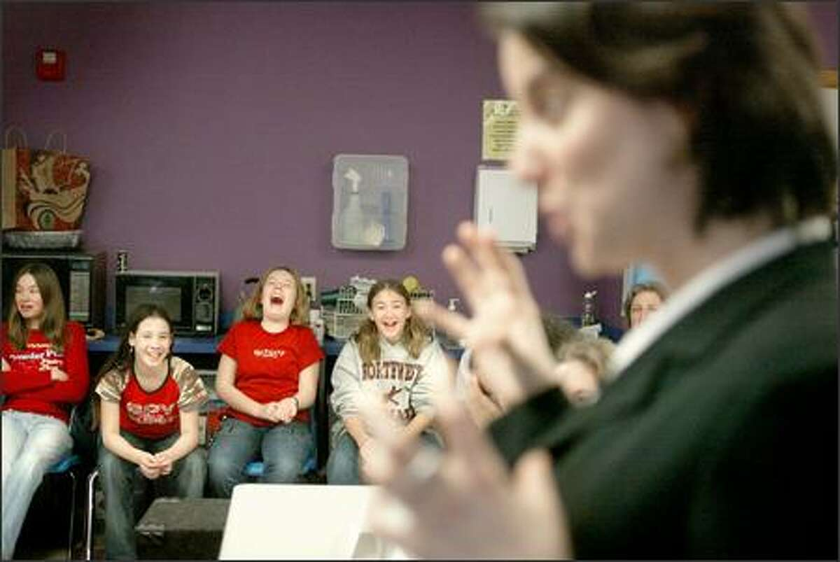 Seattle Girls' School students crack up while listening to author Rachel Simmons, whose two books shed light on the particular brand of nastiness girls inflict on one another.