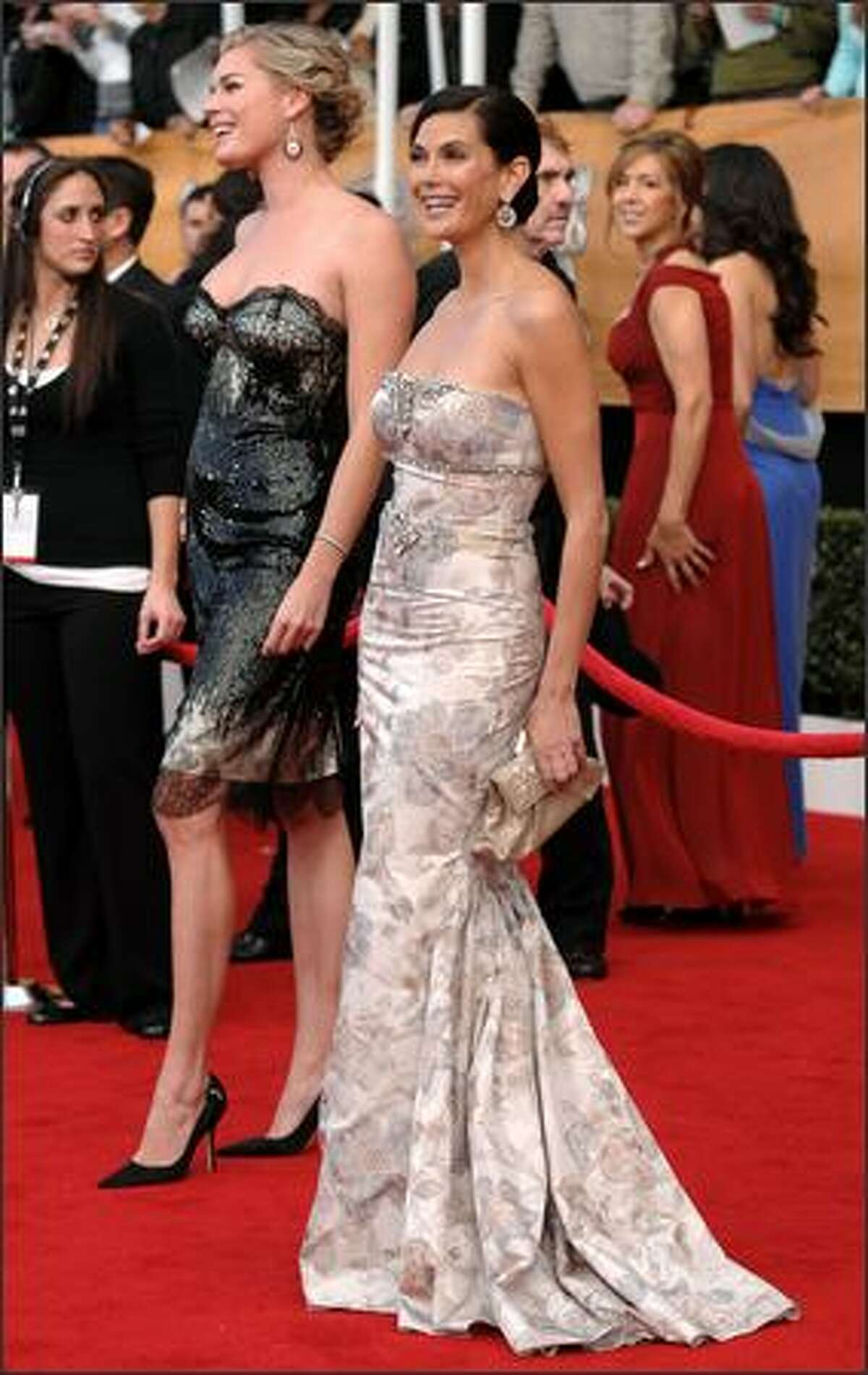 Teri Hatcher, right, and Rebecca Romijn arrive at the 14th Annual Screen Actors Guild Awards on Sunday.