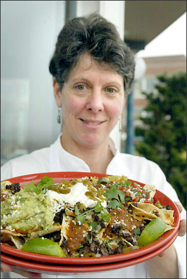 Yarrow Bay Grill's Vicky McCaffree scores a touchdown for East with her American Kobe Beef Nachos, served with sides of salsa, sour cream and guacamole. Photo: Phil H. Webber, Seattle Post-Intelligencer / Seattle Post-Intelligencer
