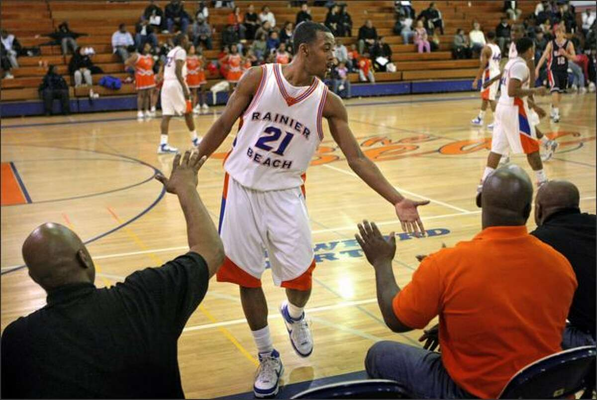Aaron Dotson of Rainier Beach returns to the bench in a recent game against Nathan Hale. Dotson transferred from Garfield last year.
