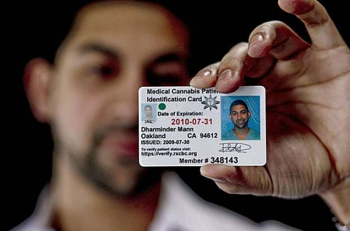 Dhar Mann, owner of iGrow, shows his official medical cannabis card.