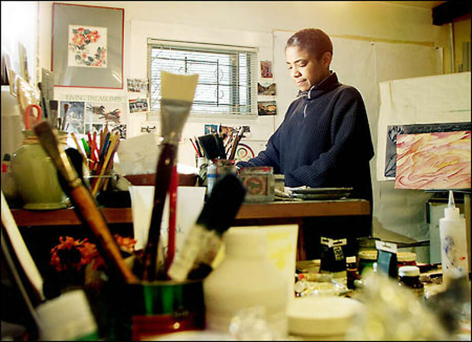 "Seattle artist Barbara Earl Thomas, at work in her studio, says of the nation's dependence on imported oil: ""I'll park my car before I send your kid overseas."" Photo: Dan DeLong, Seattle Post-Intelligencer / Seattle Post-Intelligencer"