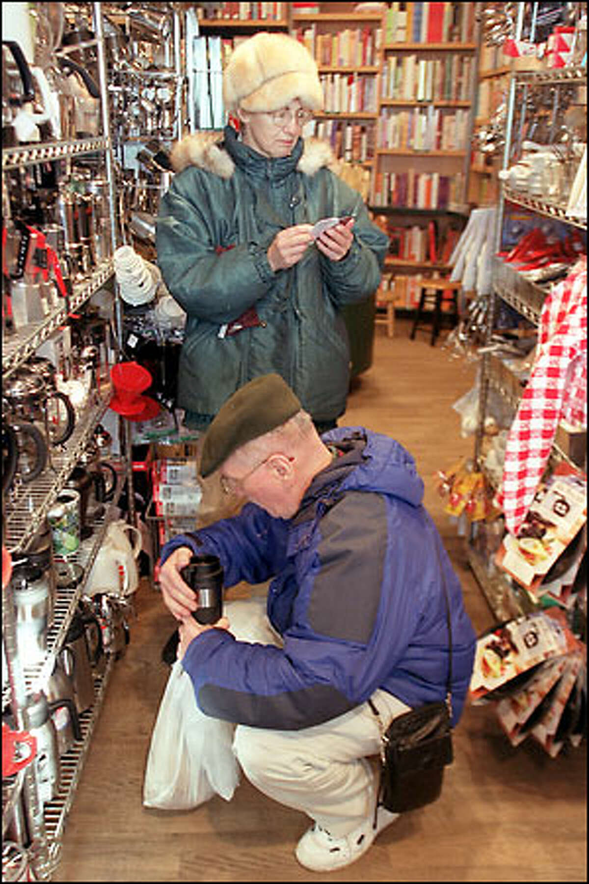 Ray and Marguerite Butz of Michigan check out the Sur La Table store in Pike Place Market. They say they go to the store when they're in Seattle and find things they can't find anywhere else. The business was founded by Shirley Collins in 1972.