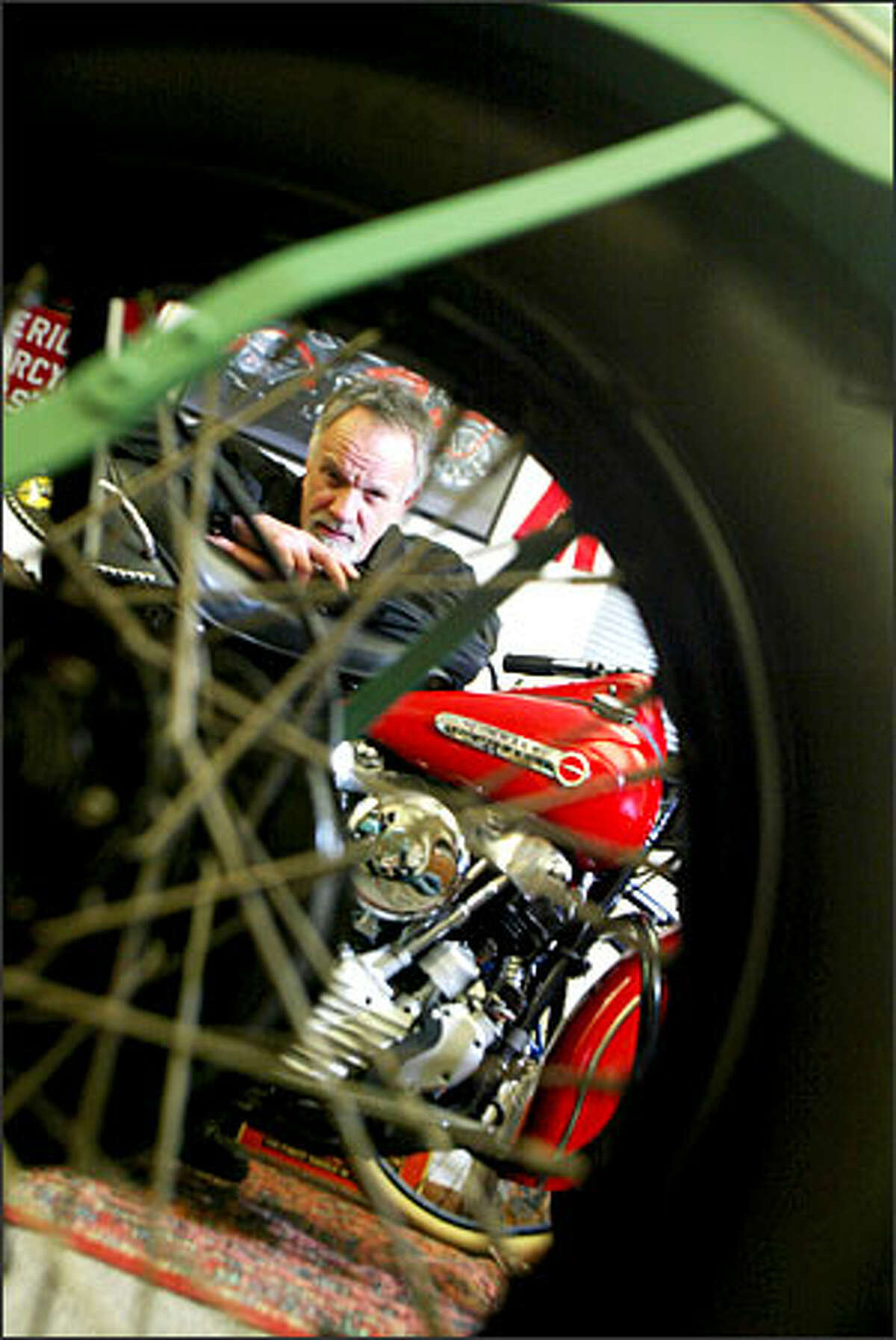 Marty Maloney leans on a 1947 Harley Davidson