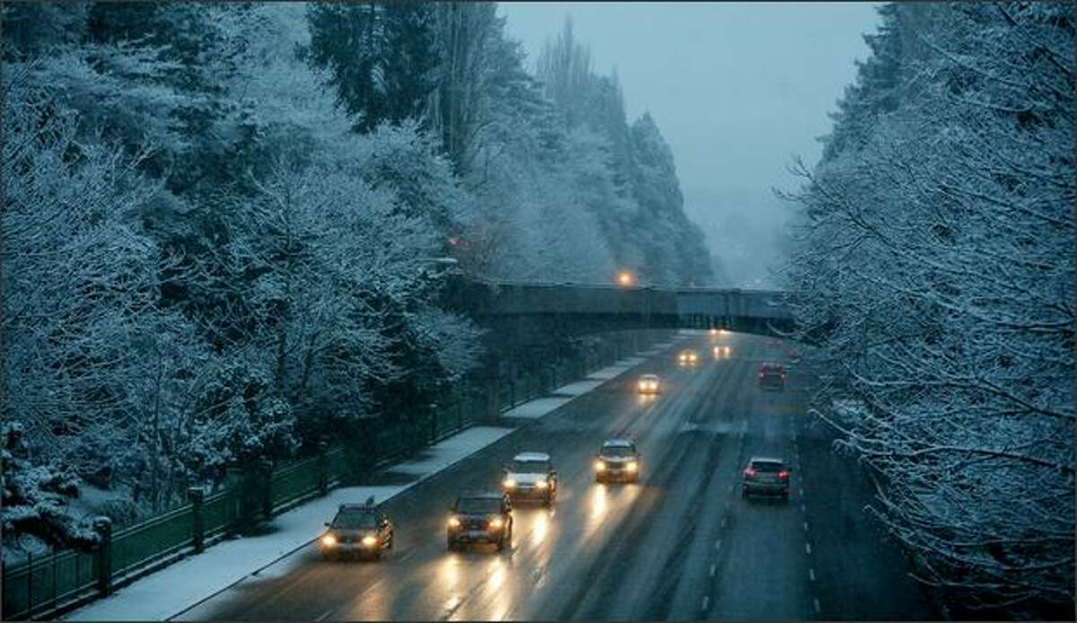 The morning commute on Hwy 99 through Woodland Park is slowed down by snow.