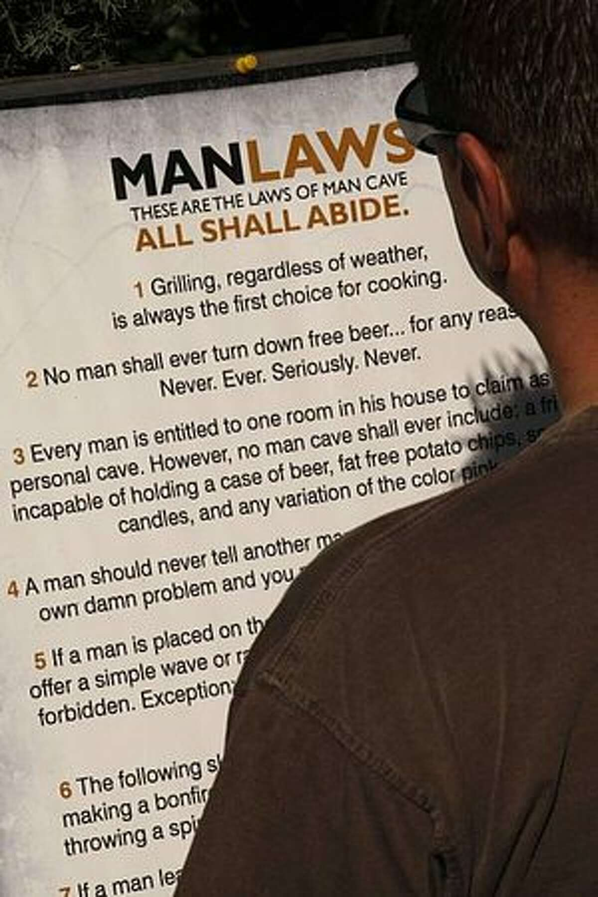 Man Cave, a company that lets men be men, has codified manly behavior in its Laws of Man Cave.