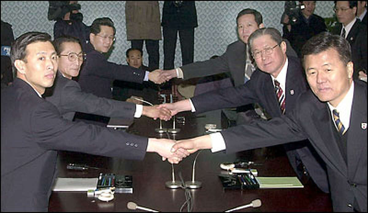 Delegates from communist North Korea, left, and pro-western South Korea open the third day of talks at a resort in the North Korean mountains.