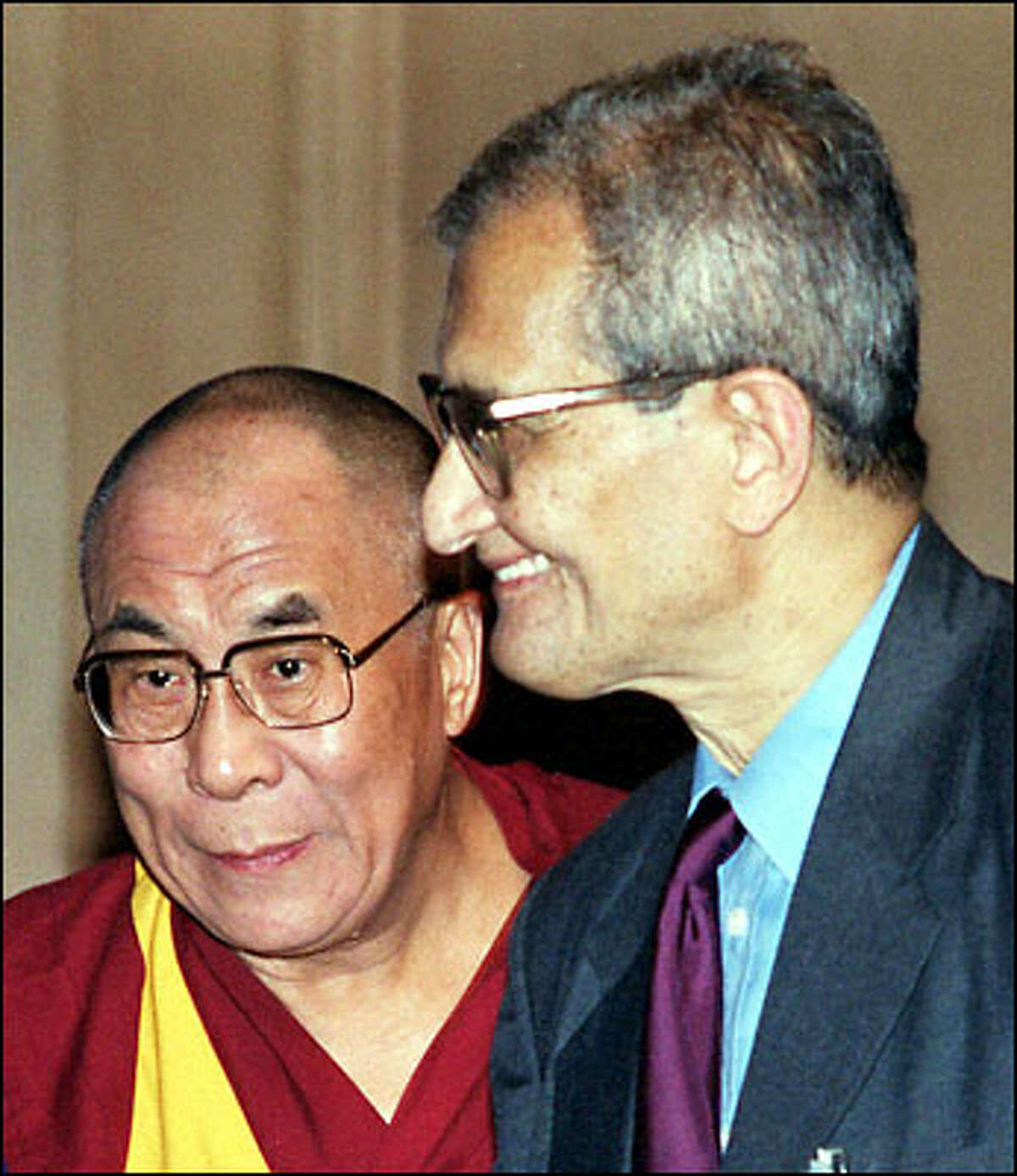 The Dalai Lama, left, winner of the Nobel Peace Prize, stands with Amartya Sen, the Nobel Prize winner for Economics, during the International Press Institute World Conference yesterday in New Delhi, India.