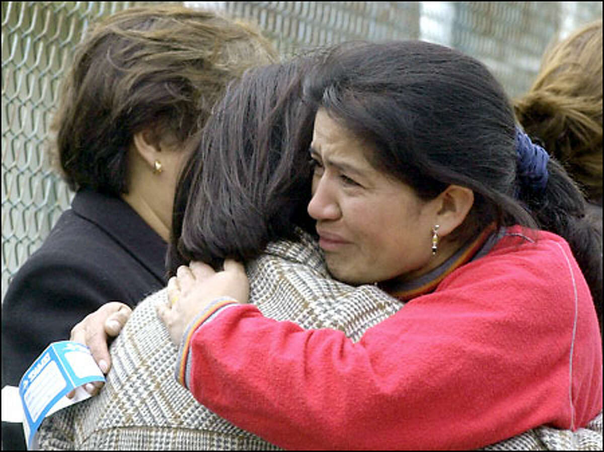 Relatives and loved ones of those who died when an Ecuadorean airliner crashed comfort each other yesterday at the airport in Tulcan, Ecuador.