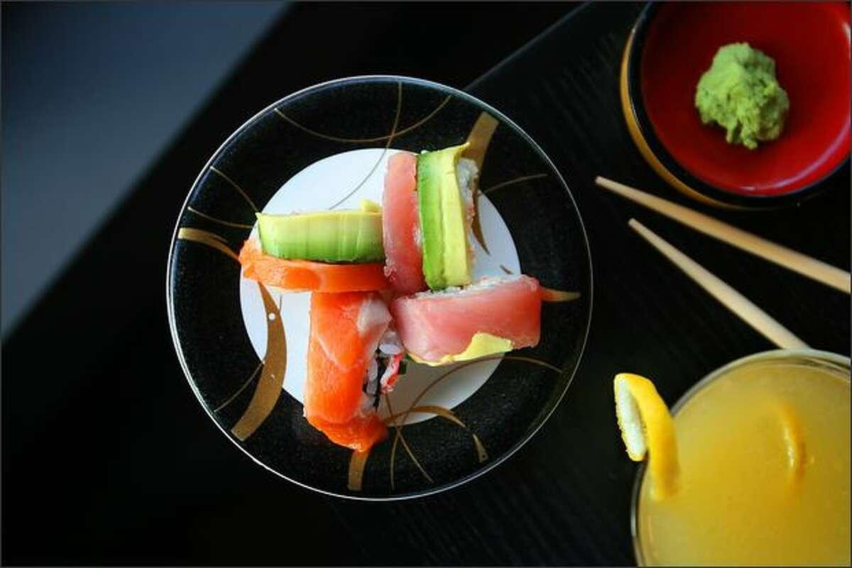 Rainbow roll, avocado, salmon and tuna sushi is served with Shanghai lemon drop.