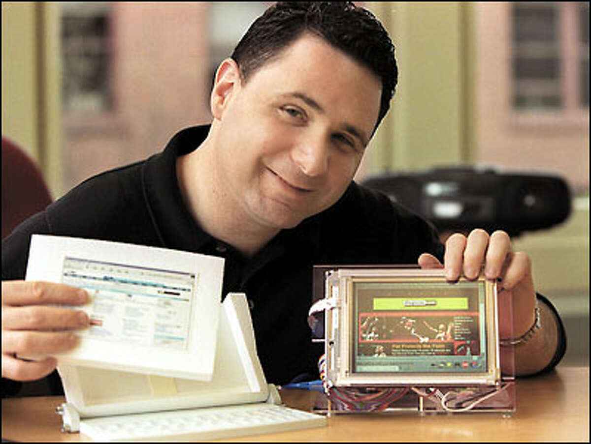 Steve Podradchik, Verge Wireless Systems chief executive officer, hopes that his company's forthcoming wireless handheld computer will fulfill techies' wish lists. Here, he displays pieces of the yet-unreleased device.