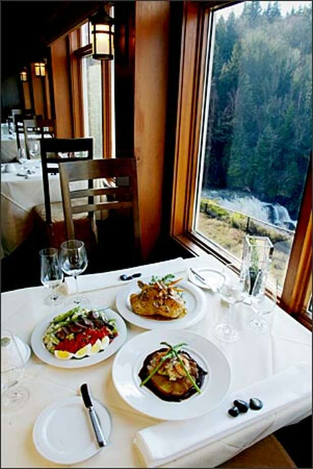 The main dining room at Salish Lodge and Spa offers great service and woodsy views. Photo: Paul Joseph Brown, Seattle Post-Intelligencer / Seattle Post-Intelligencer