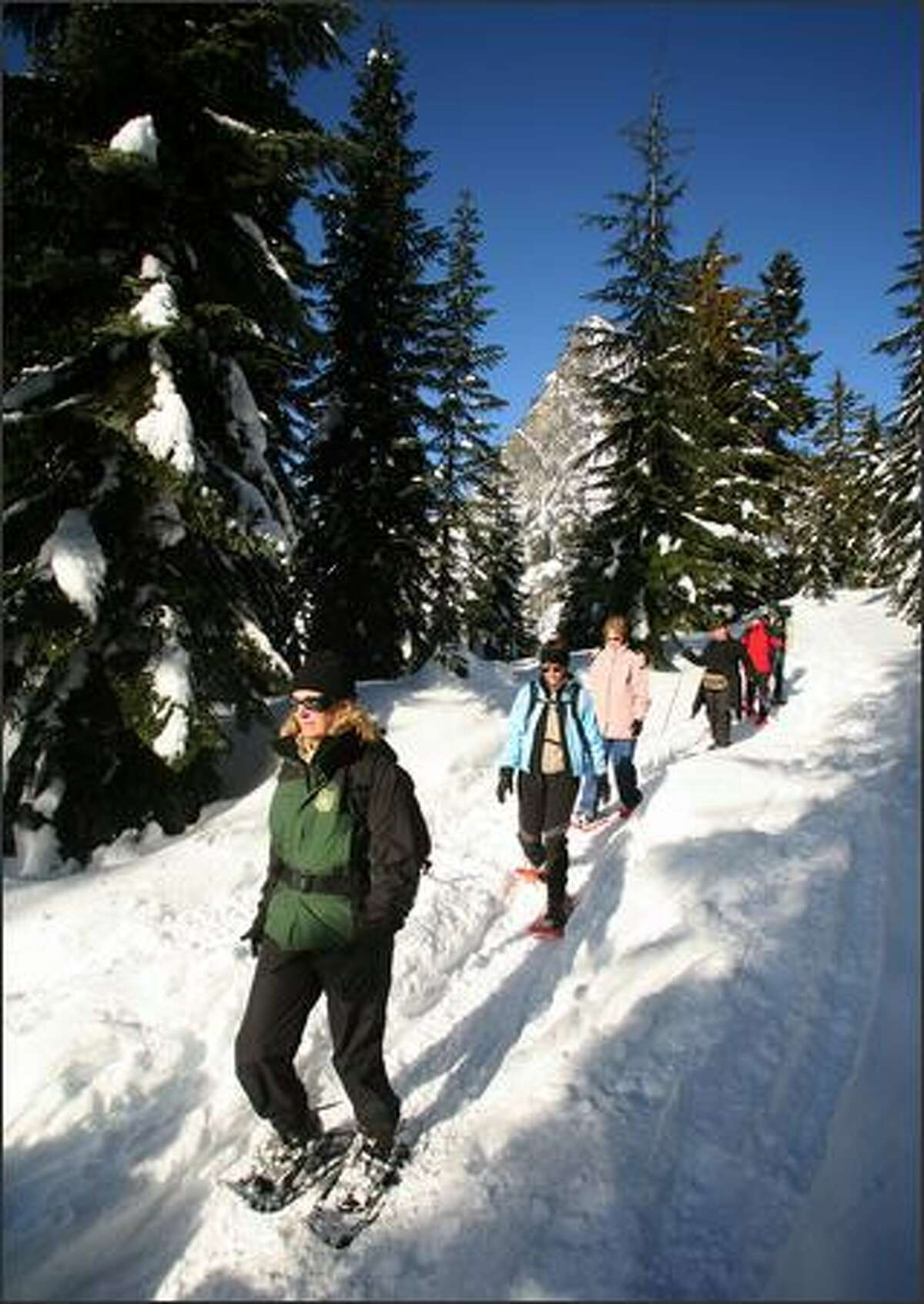 Lori Krawchuk, a Forest Service volunteer, leads her group back to Snoqualmie Pass after a scenic tromp to Commonwealth Basin.