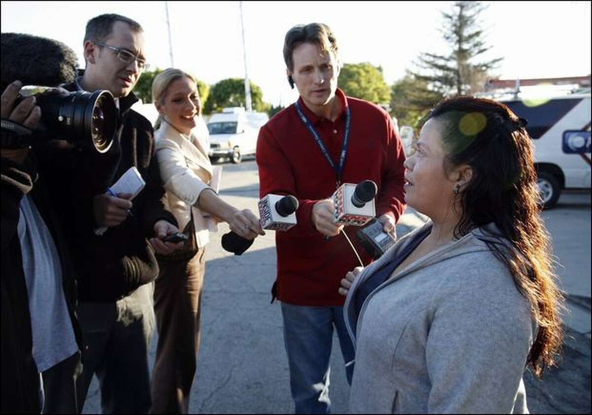 Araceli Castro, who identified herself as a nanny, talks to reporters Friday as she arrives at the Whittier, Calif., home of a woman who gave birth to octuplets this week.
