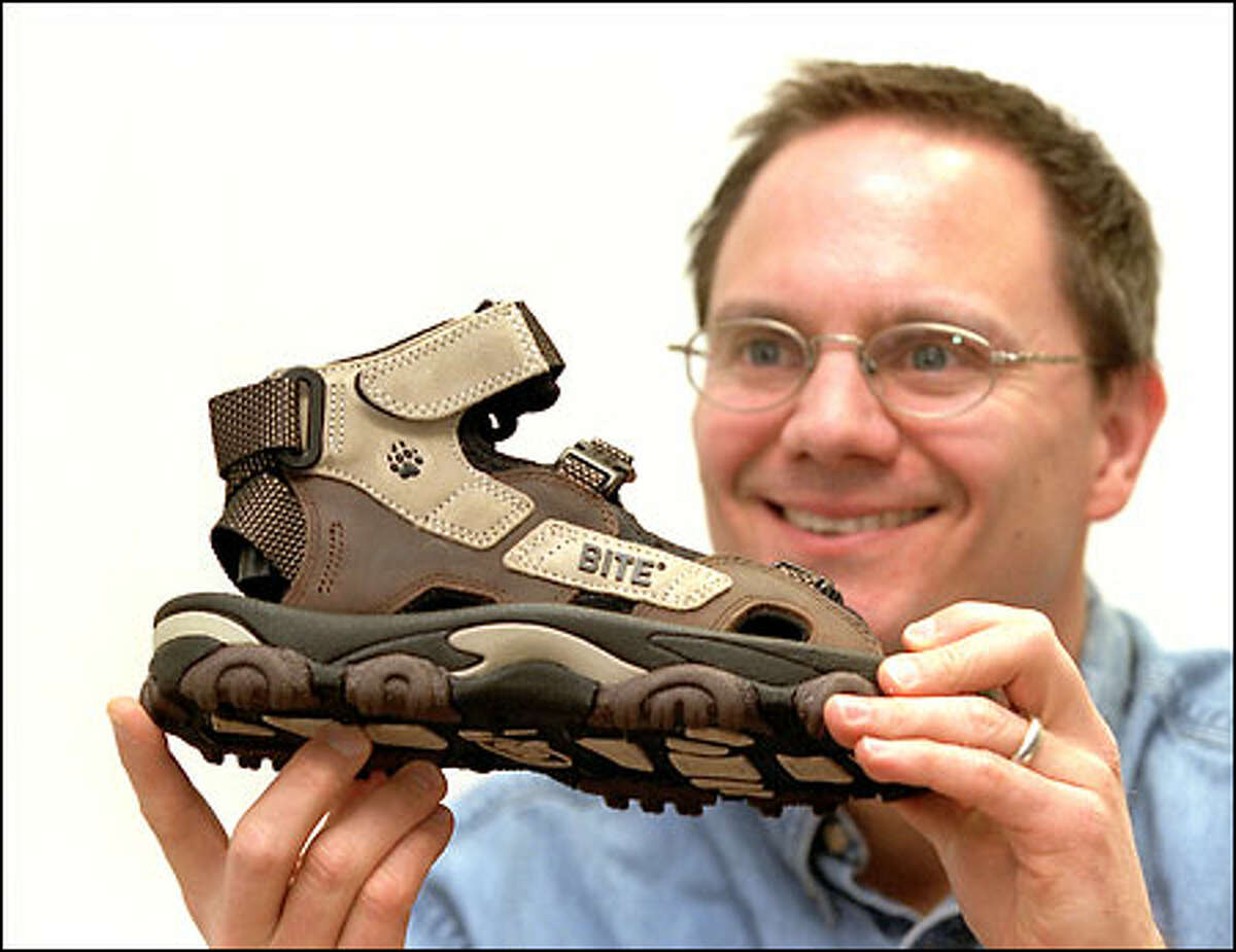 Bite Footwear founder Dale Bathum displays a sandal for serious hikers. Four patents protect its design.